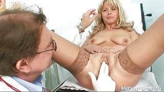 Mature keeps her stockings on for medical exam