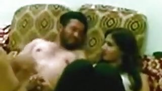 Arab slut fucks her husband in the living room, while a friend captures it.