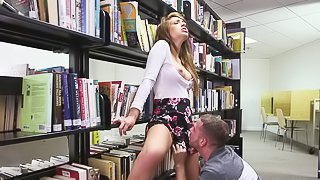 Hot chick with long legs Joseline Kelly takes off her short skirt in the library to have sex with a hot dude between the shelves . She rides his tongue and then eats his meat