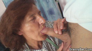 Clothed 70 years old granny rides young dick