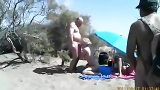 Cuckold threesome at a nude beach. spectators ? they don't give a shit !!!