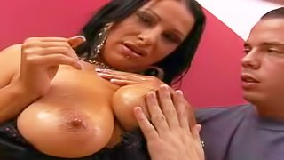 Provocative black haired curvy sexy with dark make up and big natural knockers in lingerie gets her round bums oiled while teasing dirty dude at the interview filmed in close up